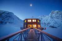 Exterior view of the Sheldon Chalet at dawn in the Ruth Glacier and Amphitheater in the Alaska Range.  Winter  <br /> <br /> Photo by Jeff Schultz/SchultzPhoto.com  (C) 2017  ALL RIGHTS RESERVED