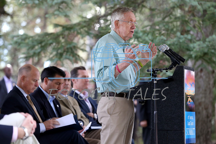 Senate Majority Leader Harry Reid speaks at the 18th annual Lake Tahoe Summit at the Valhalla Estate in South Lake Tahoe, Ca., on Tuesday, Aug. 19, 2014. Behind Reid are, from left, California Gov. Jerry Brown, Gov. Brian Sandoval, Rep. Tom McClintock, R-Calif., and California Lt. Gov. Gavin Newsom. The event, which attracts government officials, scientists and educational and environmental agencies from California and Nevada, helps focus on environmental issues key to the preservation of the Lake Tahoe basin. (Las Vegas Review-Journal/Cathleen Allison)