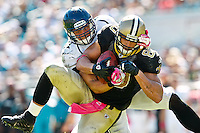October 02, 2011:   New Orleans Saints tight end Jimmy Graham (80) catches a pass while being defended by Jacksonville Jaguars middle linebacker Paul Posluszny (51) during second half action between the Jacksonville Jaguars and the New Orleans Saints at EverBank Field in Jacksonville, Florida.  New Orleans defeated Jacksonville 23-10.........
