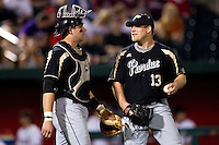 Blake Mascarello (13) of the Purdue Boilermakers walks back to the mound with Kevin Plawecki (26) during a game against the Missouri State Bears at Hammons Field on March 13, 2012 in Springfield, Missouri. (David Welker / Four Seam Images)