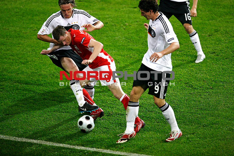 UEFA Euro 2008 Group B Klagenfurt - W&ouml;rthersee Match 04 <br /> <br /> Deutschland ( GER ) - Polen ( POL )<br /> <br /> Zweikampf zwischen Clemens Fritz ( Germany / Mittelfeldspieler / Midfielder /  Werder Bremen #4) gegen Jacek Krzynowek  ( Poland / Mittelfeldspieler / Midfielder / VfL Wolfsburg #08 ) und Mario Gomez ( Germany / Angreifer / Forward / VFB Stuttgart #9)<br /> <br /> <br /> Foto &copy; nph (  nordphoto  )<br /> <br /> <br /> <br />  *** Local Caption ***