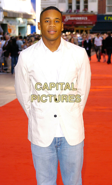 """REGGIE YATES.""""Superman Returns"""" UK film premiere, Odeon Leicester Square, London, UK..July 13th, 2006.Ref: CAN.half length white suit jacket.www.capitalpictures.com.sales@capitalpictures.com.©Capital Pictures"""