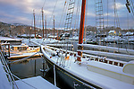 Schooners covered with snow in the harbor in Camden, Maine, USA