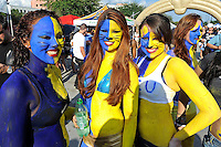 1 October 2011:  Fans who have painted themselves gold and blue make their way to the stadium prior to the game and after tailgating.  The Duke University Blue Devils defeated the FIU Golden Panthers, 31-27, at FIU Stadium in Miami, Florida.