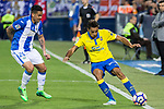 Luciano Neves of Club Deportivo Leganes competes for the ball with  during the match of La Liga between Deportivo Leganes and Union Deportiva Las Palmas  Butarque Stadium  in Madrid, Spain. April 25, 2017. (ALTERPHOTOS/Rodrigo Jimenez)