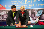 Mission Hills Vice Chairman Tenniel Chu (left) helps tennis legend Boris Becker (right) to impress his handprint on clay during the press conference for the opening of Boris Becker Tennis Academy at Mission Hills Resort on 19 March 2016, in Shenzhen, China. Photo by Lucas Schifres / Power Sport Images