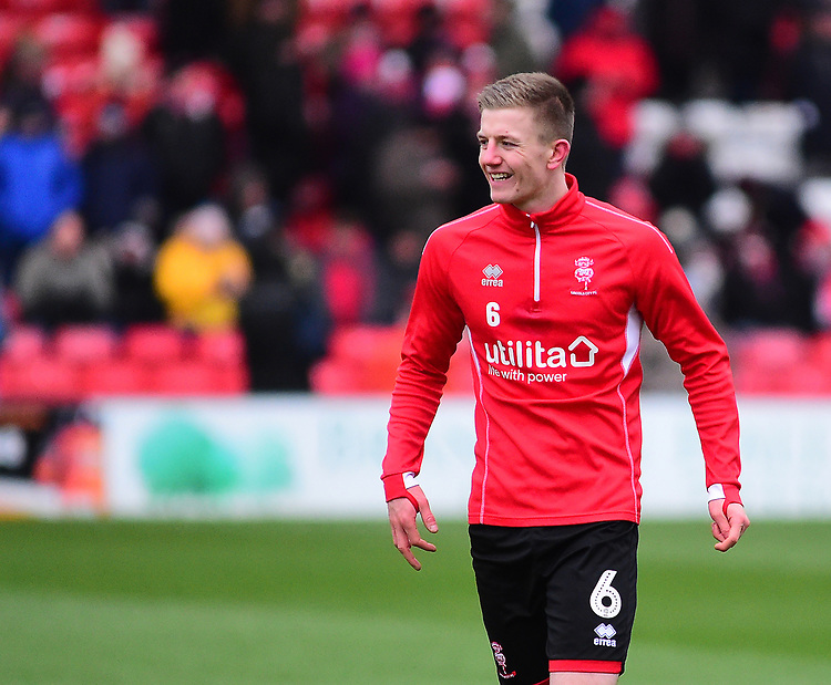 Lincoln City's Scott Wharton during the pre-match warm-up<br /> <br /> Photographer Andrew Vaughan/CameraSport<br /> <br /> The EFL Sky Bet League Two - Saturday 15th December 2018 - Lincoln City v Morecambe - Sincil Bank - Lincoln<br /> <br /> World Copyright © 2018 CameraSport. All rights reserved. 43 Linden Ave. Countesthorpe. Leicester. England. LE8 5PG - Tel: +44 (0) 116 277 4147 - admin@camerasport.com - www.camerasport.com