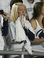 State College, PA - 10/12/2013:  A PSU fan nervously watches her team in overtime.  Penn State defeated Michigan by a score of 43-40 in 4 overtimes on Saturday, October 12, 2013, at Beaver Stadium.<br /> <br /> Photos by Joe Rokita / JoeRokita.com