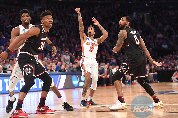 NEW YORK, NY - MARCH 26:  Kasey Hill #0 of the Florida Gators is guarded by Sindarius Thornwell #0 of the South Carolina Gamecocks during the 2017 NCAA Men's Basketball Tournament held at Madison Square Garden on March 26, 2017 in New York City. (Photo by Justin Tafoya/NCAA Photos via Getty Images)<br /> ***Local Caption***Kasey Hill; Sindarius Thornwell