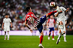 Jose Maria Gimenez of Atletico de Madrid (L) trips up with Marco Asensio of Real Madrid (R) during their La Liga  2018-19 match between Real Madrid CF and Atletico de Madrid at Santiago Bernabeu on September 29 2018 in Madrid, Spain. Photo by Diego Souto / Power Sport Images