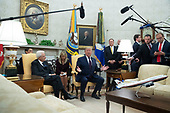 US President Donald J. Trump (C) delivers remarks as US Secretary of State Mike Pompeo (Back C) looks on; during a meeting with President of Italy Sergio Mattarella (L) in the Oval Office of the White House in Washington, DC, USA, 16 October 2019. The leaders meet to discuss a wide variety of economic and security issues such as telecommunications security, the NATO alliance and the Turkish incursion into Syria.<br /> Credit: Michael Reynolds / CNP