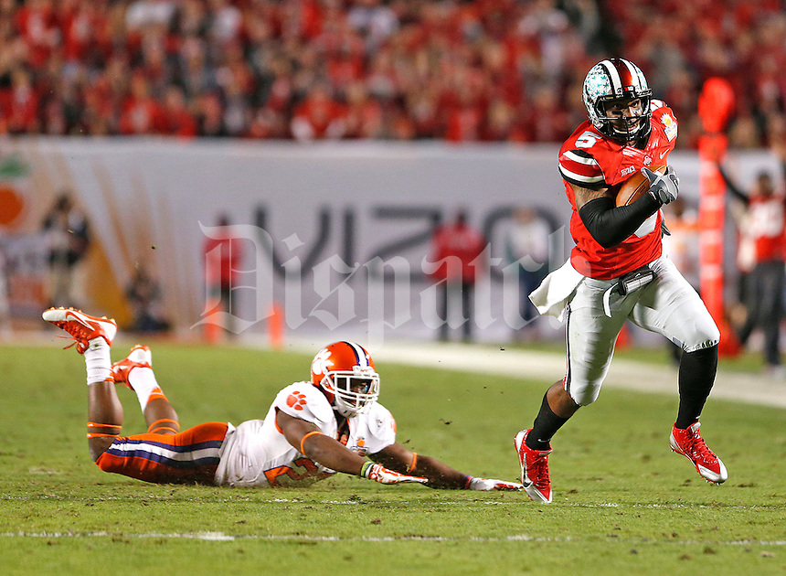 Ohio State Buckeyes quarterback Braxton Miller (5) breaks free for a first quarter TD against Clemson in the 2014 Discover Orange Bowl at Sun Life Stadium in Miami Gardens, Florida on January 3, 2014. (Chris Russell/Dispatch Photo)