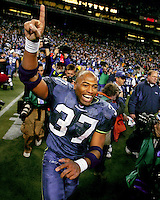 Running back Shaun Alexander runs onto the field after time expired during the NFC Championship game won by the Seattle Seahawks over the Carolina Panthers at Qwest Field Sunday, Jan. 22, 2006. (Photo by Scott Eklund)
