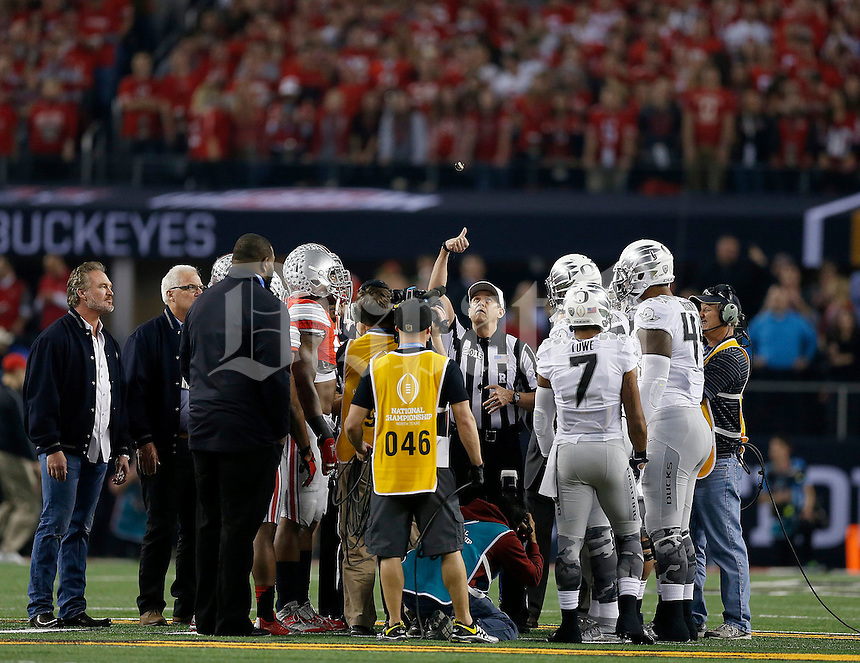 The coin toss before the College Football Playoff National Championship at AT&T Stadium in Arlington, TX on Monday, January 12, 2015. (Columbus Dispatch photo by Jonathan Quilter)