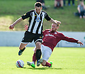 Fraserburgh's MarcDickson is challenged by   and Linlithgow's Ruari Maclennan.