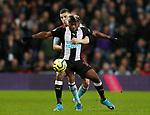 Frederic Guilbert of Aston Villa holds up Allan Saint-Maximin of Newcastle United during the Premier League match at Villa Park, Birmingham. Picture date: 25th November 2019. Picture credit should read: Darren Staples/Sportimage