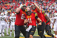 College Park, MD - October 1, 2016: Maryland Terrapins quarterback Perry Hills (11) celebrates after scoring a touchdown during game between Purdue and Maryland at  Capital One Field at Maryland Stadium in College Park, MD.  (Photo by Elliott Brown/Media Images International)