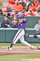 Clemson Tigers center fielder Chase Pinder (5) swings at a pitch during a game against the Maine Black Bears at Doug Kingsmore Stadium on February 20, 2016 in Clemson, South Carolina. The Tigers defeated the Black Bears 9-4. (Tony Farlow/Four Seam Images)