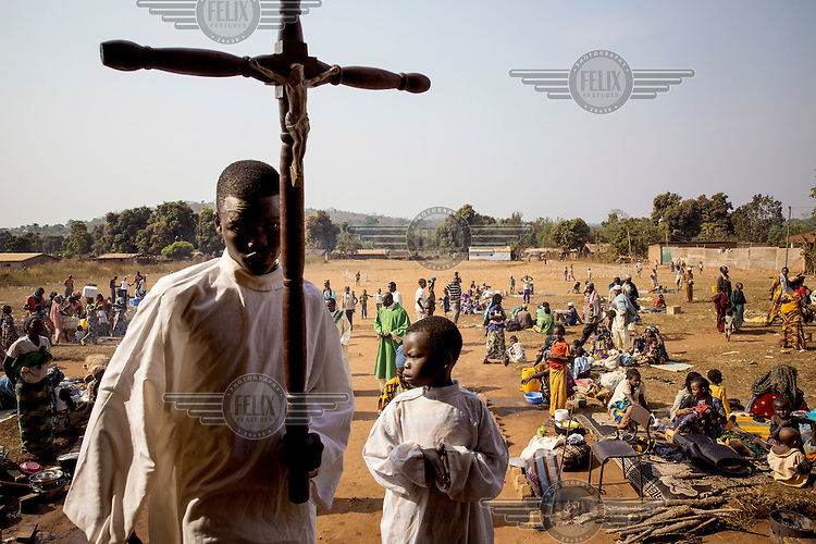 An alter boy prepares for a mass at a church where the priest offered sanctuary to a large group of Muslims who were the target of Anti-Balaka forces. In 2013 a rebellion by a predominantly Muslim rebel group Seleka, led by Michel Djotodia, toppled the government of President Francios Bozize. Djotodia declared that Seleka would be disbanded but as law and order collapsed the ex-Seleka fighters roamed the country committing atrocities against the civilian population. In response a vigillante group, calling themselves Anti-Balaka (Anti-Machete), sought to defend their lives and property but they then began to take reprisals against the Muslim population and the conflict became increasingly sectarian. French and Chadian peacekeeping forces have struggled to contain the situation and the smaller Muslim population began to flee the country.