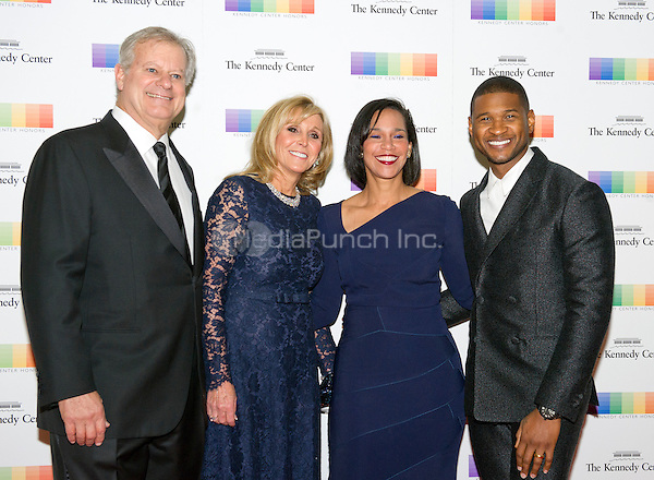 Singer Usher, right, his wife, Grace, right center, and guests arrive for the formal Artist's Dinner honoring the recipients of the 38th Annual Kennedy Center Honors hosted by United States Secretary of State John F. Kerry at the U.S. Department of State in Washington, D.C. on Saturday, December 5, 2015. The 2015 honorees are: singer-songwriter Carole King, filmmaker George Lucas, actress and singer Rita Moreno, conductor Seiji Ozawa, and actress and Broadway star Cicely Tyson.<br /> Credit: Ron Sachs / Pool via CNP/MediaPunch