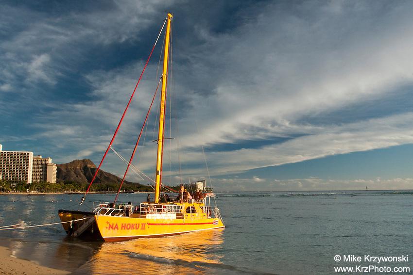Na Hoku II catamaran docked at the beach in Waikiki, Honolulu, Oahu, Hawaii