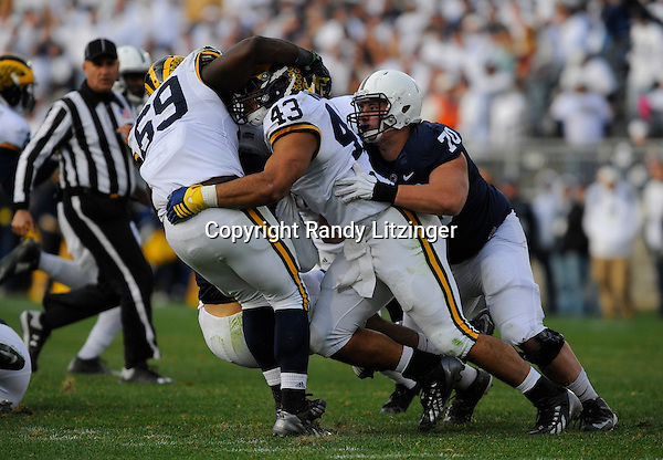21 November 2015:  Michigan DE Willie Henry (69) and DT Chris Wormley (43) sack Penn State QB Christian Hackenberg (14). The Michigan Wolverines defeated the Penn State Nittany Lions 28-16 at Beaver Stadium in State College, PA. (Photo by Randy Litzinger/Icon Sportswire)