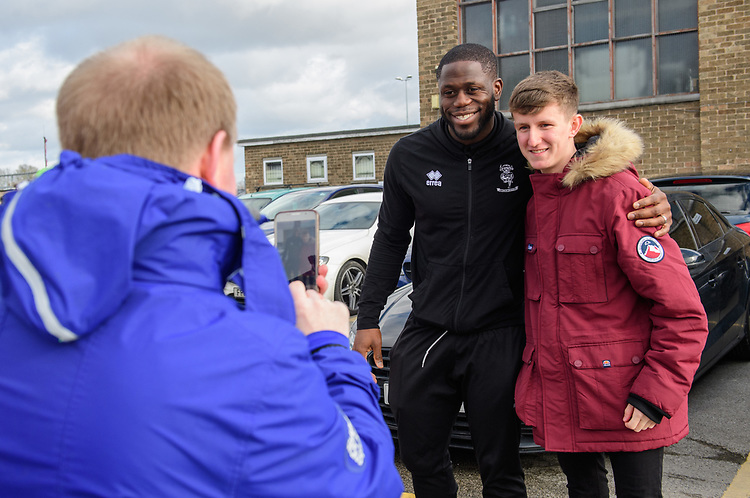 Lincoln City's John Akinde poses for a photograph with fans before kick off<br /> <br /> Photographer Chris Vaughan/CameraSport<br /> <br /> The EFL Sky Bet League Two - Lincoln City v Northampton Town - Saturday 9th February 2019 - Sincil Bank - Lincoln<br /> <br /> World Copyright &copy; 2019 CameraSport. All rights reserved. 43 Linden Ave. Countesthorpe. Leicester. England. LE8 5PG - Tel: +44 (0) 116 277 4147 - admin@camerasport.com - www.camerasport.com