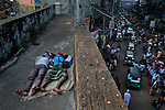 Homeless Bangladeshi boys sleep on an overpass early morning in Dhaka, Bangladesh.