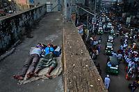 Homeless Bangladeshi boys sleep on an overpass early morning in Dhaka, Bangladesh.