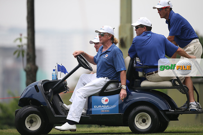 Team Europe Captain, Miguel Angel Jimenez (ESP) using the buggy to rally his players during the final day of Singles matches at the 2014 EurAsia Cup presented by DRB-Hicom, at the Glenmarie Golf & Country Club, Kuala Lumpur, Malaysia. Picture:  David Lloyd / www.golffile.ie