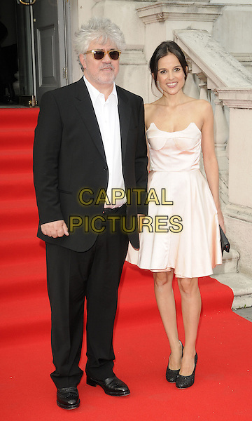 "PEDRO ALMODOVAR & ELENA ANAYA.""The Skin I Live In"" opening night film to launch the Film4  Summer Screen Series, Somerset House, the Strand, London, England..July 27th, 2011.full length black suit white shirt pink dress strapless sunglasses shades .CAP/CAN.©Can Nguyen/Capital Pictures."