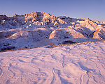 drifted snow and badlands, Badlands National Park, South Dakota