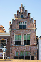 Tourist views traditional architecture lopsided ancient building of theTown Hall and Museum, Edam, The Netherlands