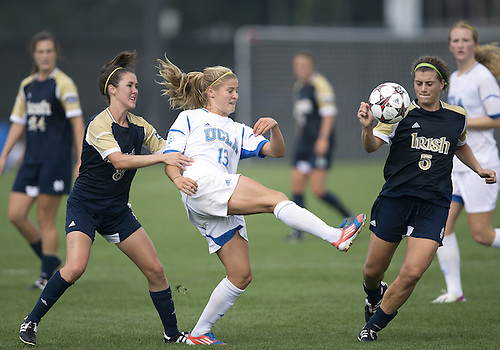 September 01, 2013:  UCLA forward Rosie White (13) clears the ball as Notre Dame midfielder Elizabeth Tucker (8) and Notre Dame forward Cari Roccaro (5) attack during NCAA Soccer match between the Notre Dame Fighting Irish and the UCLA Bruins at Alumni Stadium in South Bend, Indiana.  UCLA defeated Notre Dame 1-0.