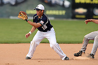April 15,2010:  Second Baseman Leandro Pereira (18) of the Genesee Community College (GCC) Cougars Men's Baseball Team in the field vs. Alfred State at Dwyer Stadium in Batavia, NY.  Photo Copyright Mike Janes Photography 2010
