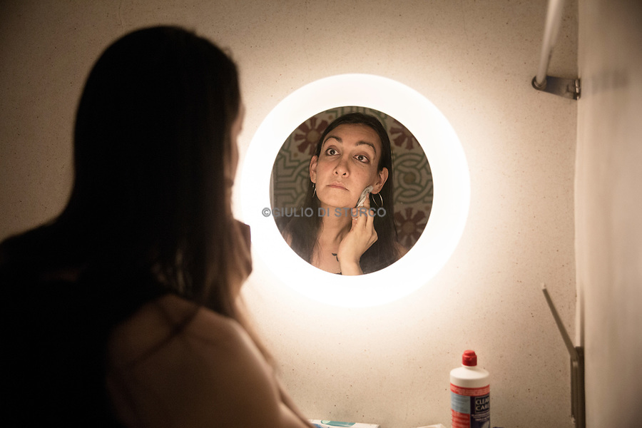 """Olivia in her hotel room in Bangkok, as she gets ready to go and meet Dr. Suporn, who will perform the gender reassignment operation on her.<br /> <br /> Olivia Thomas, 38, started to take hormones in November 20, 2009<br /> <br /> When Olivia was still living as a man he was married with Andrea and he had a daughter.            <br /> <br /> """"I knew I was different from a very early age, around age 9. I believed doctors had surgically given me the wrong parts at birth. However, as I was told I was a boy by my parents, that is what I believed. As a teenager, I started dressing in women's clothes and wondered what it would be like to have a female body and breasts. I repressed these thoughts and feelings through my twenties, and it wasn't until I was nearly thirty that I realized I was transgender. I was married at that time and had a newly born daughter. I then started my transition in earnest, going through the process of coming out to family, then friends, then my work. I found acceptance from many friends and work colleagues, but some family members were and continue to be resistant to my transition. After starting hormones in November 2009, I had Facial Feminization Surgery (FFS) in November 2012 with Dr. Mark Zukowski in Chicago, Illinois, USA. Finally, on January 30, 2017, I was able to have Gender Reassignment Surgery (GRS) with Dr. Suporn in Chon Buri, Thailand.<br /> <br /> She is currently working in the motorcycle industry as a repair technician."""