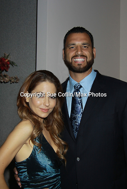"General Hospital Lisa LoCicero ""Olivia Falconeri"", Loving ""Joscelyn Roberts Brown moving onto The City, One Life To Live ""Sonia Toledo Santi"" poses with Anthony Becht NFL player (Sports Celebrity Marshal) at the Soroptimist Grand Ball during the 32nd Annual Mountain State Apple Harvest Festival on October 15, 2011 at the Heritage Hall, Inwood, WV.  (Photo by Sue Coflin/Max Photos)"