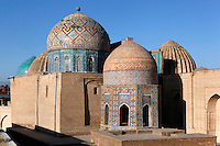General view of Shah-I Zinda Complex showing  Mausoleum of the middle group (right), octagonal pavilion, Mausoleum of the 1380s, (behind on the left), Samarkand, Uzbekistan, pictured on July 19, 2010, at dawn. The Shah-i-Zinda Complex is a necropolis of mausoleums whose legendary origin dates back to 676 when Kussam-ibn-Abbas arrived to convert the locals to Islam. So successful was he that he was assassinated whilst at prayer. His grave remains the centre of the sacred site which grew over many centuries, especially the 14th and 15th, into an architecturally stunning  example of ceramic art. Samarkand, a city on the Silk Road, founded as Afrosiab in the 7th century BC, is a meeting point for the world's cultures. Its most important development was in the Timurid period, 14th to 15th centuries. Picture by Manuel Cohen.