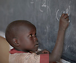 A boy writes on the chalkboard in a class at the Loreto Primary School in Rumbek, South Sudan. While focused on educating girls from throughout the war-torn country, the school, run by the Institute for the Blessed Virgin Mary--the Loreto Sisters--of Ireland, also educates children from nearby communities.