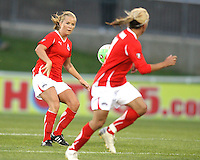 Lene Mykjvelan #7 of the Washington Freedom passes the ball to Lisa De Vanna #11 during a WPS match against the Atlanta Beat on April 18 2010, at the Maryland Soccerplex, in Boyds, Maryland.