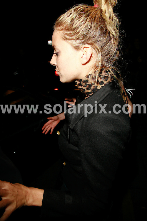 **ALL ROUND PICTURES FROM SOLARPIX.COM**.*WORLDWIDE RIGHTS*.Sienna Miller leaves the Groucho Club in London hastily through the side entrance trying to avoid large number of photographers by front door - she was previously surprised photographers let her smoke a cigarette without taking any pictures, all hoping she would pose up for a photo after, but she just went back into the club. She nearly gave the photographers the slip, climbed into the car and then thought maybe she had left someone so got out and wandered back in a drunken state. As many snappers were there on route she hid in a doorway and when she found her sister and driver she made her escape. A homeless.person started to swing punches at photographers as he thought Sienna was being harrassed. As Savannah and Sienna held hands and walked he was in the middle aggressively shouting at photographers to move out of the way. Eventually Sienna and Savannah got into the car and drove off...This pic: Sienna Miller..JOB REF: 4705 GMT   DATE: 13_09_2007.**MUST CREDIT SOLARPIX.COM OR DOUBLE FEE WILL BE CHARGED* *UNDER NO CIRCUMSTANCES IS THIS IMAGE TO BE REPRODUCED FOR ANY ONLINE EDITION WITHOUT PRIOR PERMISSION*
