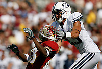 TALLAHASSEE, FL 9/18/10-FSU-BYU FB10 CH-Florida State's Bert Reed has his helmet removed by Brigham Young's Travis Uale during first half action Saturday at Doak Campbell Stadium in Tallahassee. No penalty was called on the play..COLIN HACKLEY PHOTO