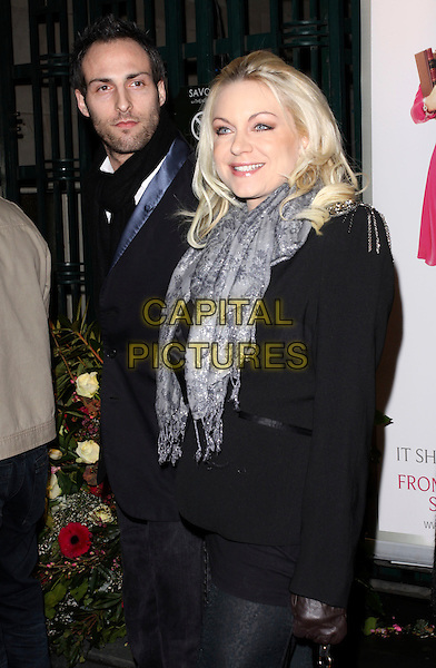 "RITA SIMONS .Attending the ""Legally Blonde"" musical Gala Performance, Savoy Theatre, London, England, UK, .13th January 2010..arrivals half length black  jacket scarf grey gray silver .CAP/AH.©Adam Houghton/Capital Pictures."