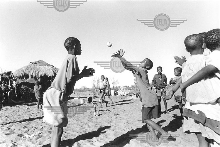 © Paul Weinberg / Panos Pictures..Bushmanland, BOTSWANA..San Bushman kids performing a melon dance.