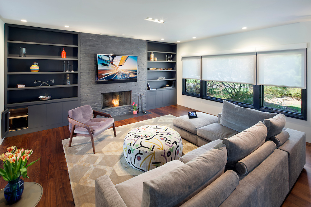 This modern Media room has an open floor plan for an area to watch movies without the equipment interfering with the clean contemporary design.