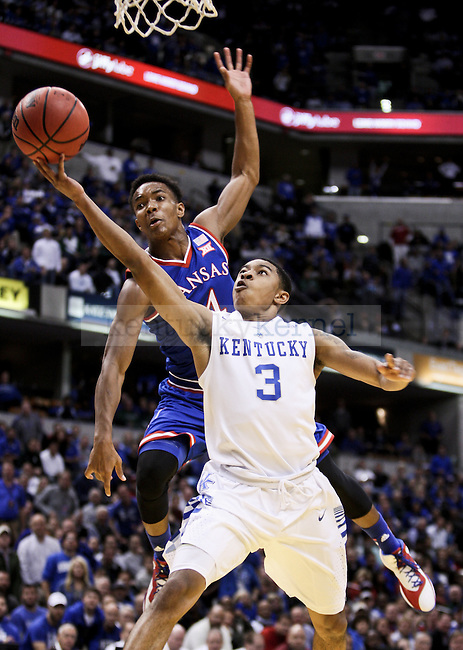 Kentucky freshman Tyler Ulis gets hit while driving to the basket during the second half of the University of Kentucky vs. Kansas University men's Basketball game at Bankers Life Fieldhouse in Indianapolis , In., on Tuesday, November 18, 2014 Kentucky won 72-40 over Kansas. Photo by Jonathan Krueger | Staff