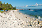 A beautiful beach on the ocean side of the island of Kiritimati in Kiribati. The commercial pier is in the background.