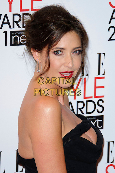 LISA SNOWDON .2011 ELLE Style Awards at the Grand Connaught Rooms, London, England, UK, February 14th, 2011..portrait headshot side hair up  black cut out strapless cleavage make-up red lipstick beauty .CAP/CJ.©Chris Joseph/Capital Pictures.