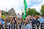 Ballylongford NS Green Flag Launch: Kerry Footballer Tom O'Sullivan hoisting the Green Flag at Ballylongford NS on Friday last.