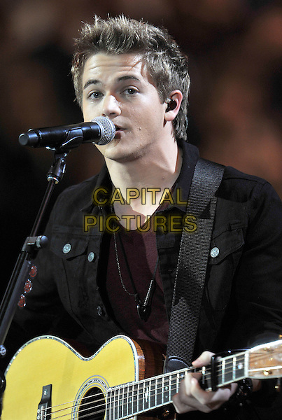 Hunter Hayes.The Grammy Nominations Concert Live, held at Bridgestone Arena,Nashville, Tennessee, USA, 5th December 2012..music grammys  half length  playing guitar black microphone singing on stage gig show .CAP/ADM/FB.©Frederick Breedon/AdMedia/Capital Pictures.